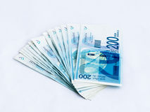 Several new banknotes worth 200 Israeli  new shekels on a white background. Several new banknotes worth 200 Israeli new shekels on a white background Royalty Free Stock Photography