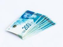 Several new banknotes worth 200 Israeli new shekels  on a white background. Several new banknotes worth 200 Israeli new shekels on a white background Stock Photo