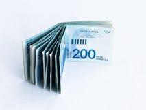 Several new banknotes worth 200 Israeli  new shekels on a white background. Several new banknotes worth 200 Israeli new shekels on a white background Stock Photos