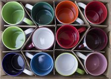 Several new mugs in a carton royalty free stock images