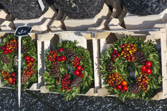 Several new years wreathes with cones. And rowan berries in the shop Stock Photo