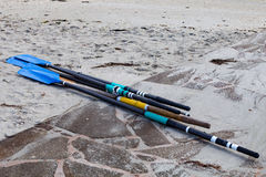 Several oars on the sand. At the beach Royalty Free Stock Photos