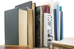 Several old books and network hard drive Stock Photo
