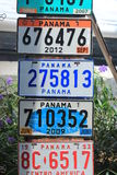 Several old car number plates placed in a marketplace in the old city of Panama Stock Photo