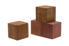 Several old cubes of wood, used by children for building Royalty Free Stock Photos