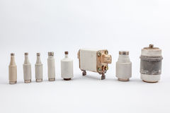 Several old fuse. With an white background there are several old fuse royalty free stock photography