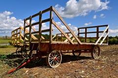 Od hay racks for hauling bundles of grain. Several old hayracks for hauling wheat and oat bundles with steel wheels stock photos