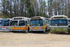 Several old, historic transportation buses, Seashore Trolley Museum,Kennebunkport,Maine,2016 Stock Photos