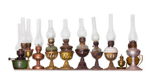 Several old kerosene lamp on a light background Royalty Free Stock Photo
