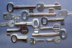 Several old keys. On a metal background Stock Images