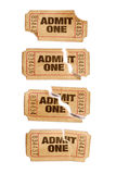 Several old torn and stained admit one movie tickets, white background, close up. Several old torn and stained admit one movie tickets royalty free stock photography