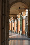 Several orange historical columns as gallery Royalty Free Stock Photography