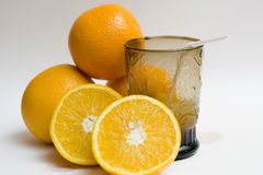 Several oranges and a glass of juice buscar Stock Photo
