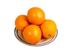 Several oranges in an old dish Royalty Free Stock Photos