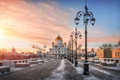 Several ornate lanter. Pink sunset at Cathedral of Christ the Saviour and a number of ornate lamps Stock Image