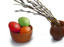 Several osier of willow and colored Easter eggs Stock Images