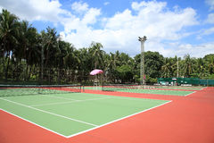 Several outdoor tennis hard courts Stock Images
