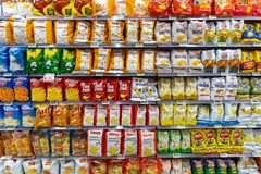 Several packs of chips and snack. Shelves with different brands of potato chips. Rome, Italy. December 05, 2018: Several packs of chips and snack inside a MA stock image