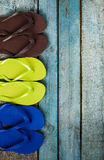Several pairs of multi-colored rubber flip-flops exhibited in a Stock Photography