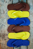 Several pairs of multi-colored rubber flip-flops exhibited in a Stock Photos