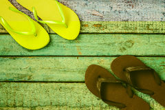 Several pairs of multi-colored rubber flip-flops exhibited in a Royalty Free Stock Photo