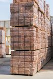 Several pallets with concrete brick stacked on top of each other in depot. new bricks on pallets stock image