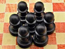 Several pawns black. Color on a board Royalty Free Stock Photography