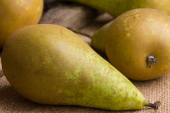 Several pears conference on brown linen background - closeup Stock Images