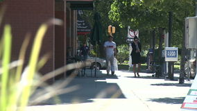 Several pedestrians on quiet sidewalk (3 of 3). A view or scene from around town stock video