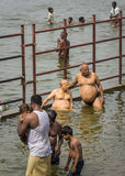 Several people bath ritually in Cauvery River. Royalty Free Stock Photo