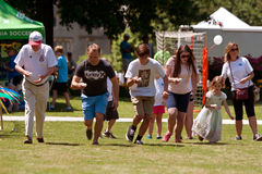 Several People Compete In Egg And Spoon Race At Festival stock photos