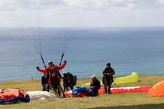 Several people getting ready to take off under sunny skies, Torrey Pines Gliderport, La Jolla, California, 2016. Several visitors gearing up and getting ready stock images