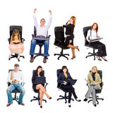 Several people in office chairs