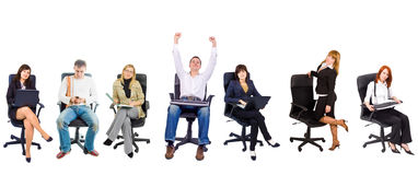 Several people in office chairs Royalty Free Stock Photos