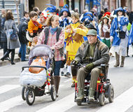 Several people participate in the carnival parade Stock Photography