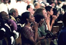 Several people praying in a church service iPeople. Several people praying during a church service in Lahnam, Maryland royalty free stock photos