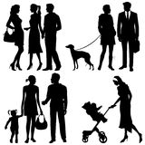Several people on the street - silhouettes Royalty Free Stock Photo