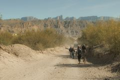 Walking into the Boquillas, Mexico. Several people walking and riding into town in the Boquillas, Mexico Stock Images