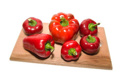 Several  peppers on a wooden cutting board. Stock Photography