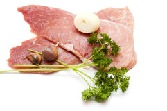 Several pieces of meat with garlic Stock Photo