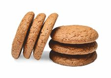 Several pieces of oatmeal cookies are hilted on top of each other. White isolated background. Close quarters. royalty free stock images