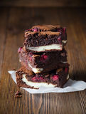 Several pieces of raspberry brownie Stock Images