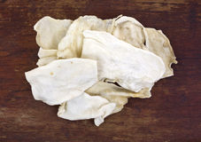 Several pieces of rawhide dog chews Royalty Free Stock Image