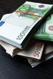 pile money cash with rubber. Euro cash money on black background royalty free stock image