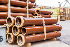Several pipes stacked in yard Royalty Free Stock Photos