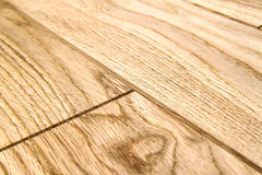 Several planks of beautiful laminate or parquet flooring with wooden texture as background stock image