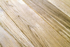 Several planks of beautiful laminate or parquet flooring with wooden texture as background royalty free stock images