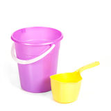Several plastic basins with ladles Stock Photos