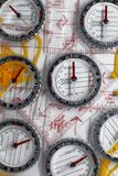 Several plastic transparent compasses. With ruler for orienteering or rogaining sport on white background Stock Photo