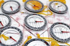 Several plastic transparent compasses. With ruler for orienteering or rogaining sport on white background Stock Image